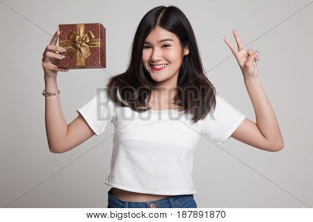 Young Asian Woman Show Victory Sign With A Gift Box.