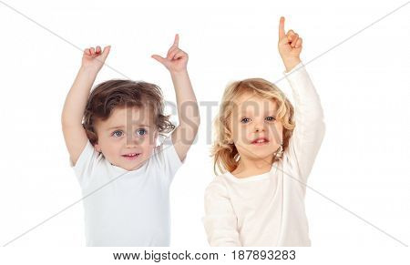 Two babies with their hands raised asking for the word isolated on a white background
