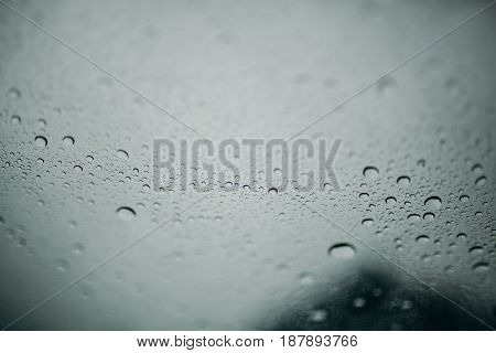 Water drops in a clear transparent glass texture.