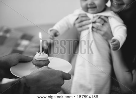 Muffin cake and candle for birthday celebration.