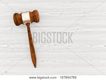Auction Hammer on white wooden table 3d illustration - view from above