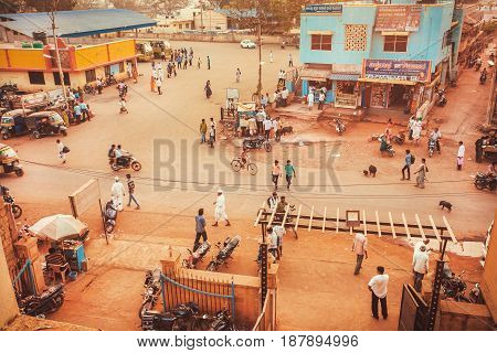 KARNATAKA, INDIA - FEB 10, 2017: Busy street of an indian city with stores hotels and transport traffic outdoor on February 10, 2017. Population of Karnataka state is 62000000 people