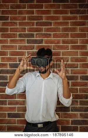 Close up portrait of a man wearing virtual reality headset.