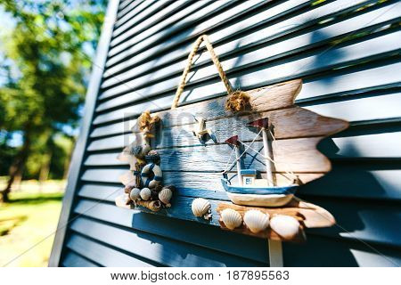 Sea Theme Decorations. Decorative Photo And Marine Items On Wooden Background.