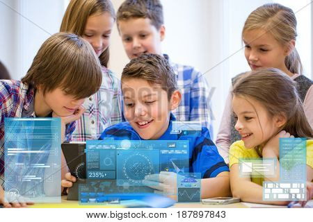 education, elementary school, learning, technology and people concept - group of kids with tablet pc computer having fun on break in classroom over virtual screens projections