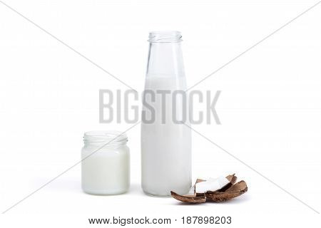 Organic Coconut Oil In Glass Jar And Coconut Milk In Glass Bottle Isolated On White, Coconut Drink C