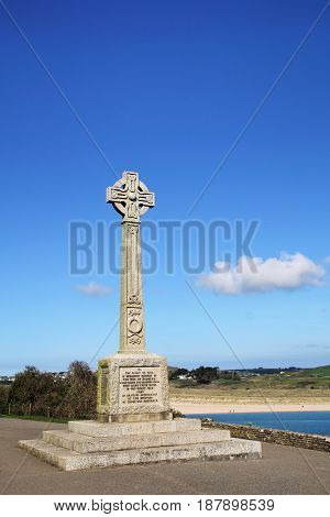 War memorial for the Great War of 1914 - 1918 on a promenade overlooking the English coast blue sky with white clouds