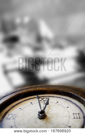 concept of lunch time with an old skeleton clock on a stove-top