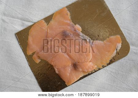 smoked salmon slices on Its package to prepare appetisers