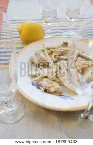 baked gilthead filled seasonid with olive oil and lemon