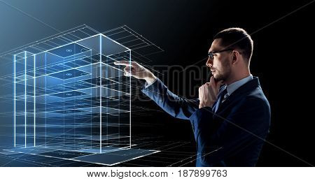 business, people and future technology concept - businessman in glasses with virtual construction hologram over black background