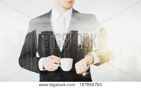 people, business and time concept - close up of businessman with wristwatch and coffee over city with double exposure