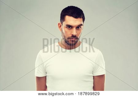 people concept - young man portrait over gray background