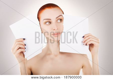 young red haired woman with white paper space for text