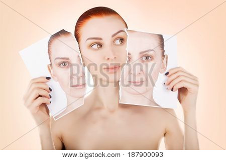 skin lifting red haired woman portrait on pink