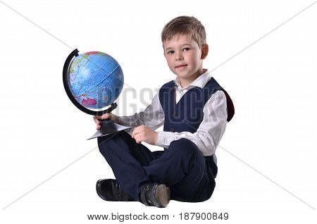 Siiting schoolboy hold a globe of world isolated on white background