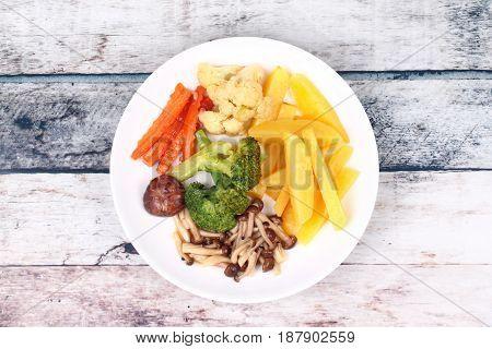 Fried Potato And Shimeji Mushroom With Mixed Vegetables.