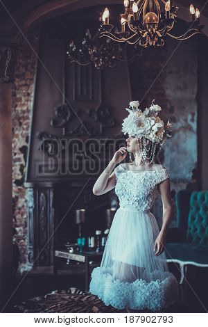 Elegant wedding dress and crown. Gorgeous woman. Tender bride in