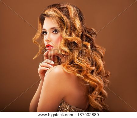 Beautiful girl with long wavy hair. Blonde with curly hairstyle and pink  lips.