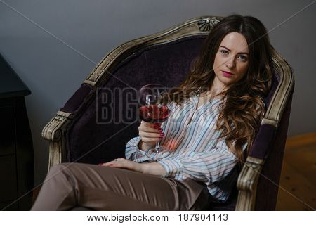 Attractive Brunette Holding A Glass Of Wine