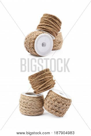 Pile of decorational rope string bobbins isolated over the white background, set of two different foreshortenings