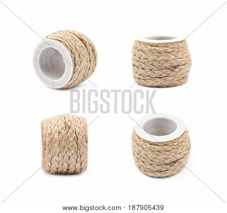 Decorational rope string on a bobbin isolated over the white background, set of four different foreshortenings