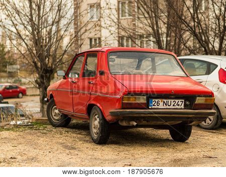 Eskisehir Turkey - March 13 2017: Old family car 1974 Red Renault 12 TS parked in the garden in Eskisehir.