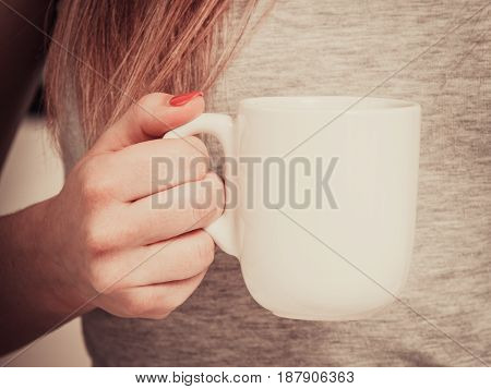 Woman On Bed With Cup Of Coffee