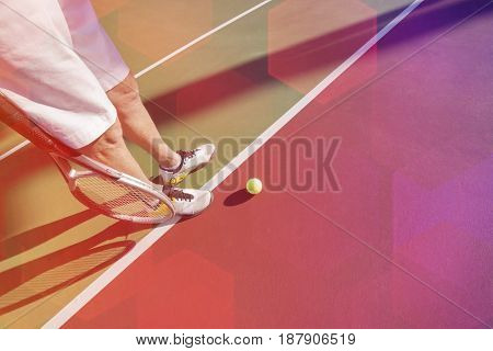 Low section of male tennis player on court