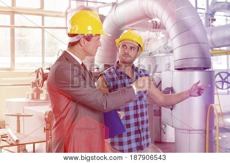 Worker with manager inspecting industrial area