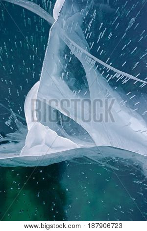Ice structure or texture in teal blue colors, close-up, abstract background