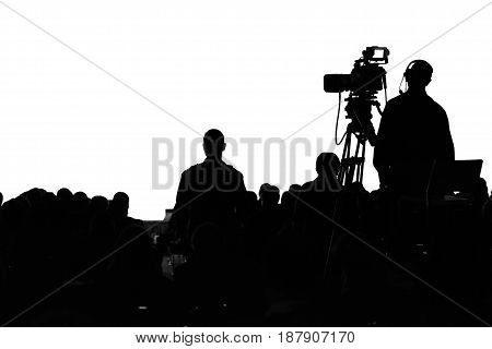 Television Press Conference production camerama operator silhouette