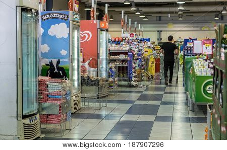 Undefined Man Walking With His Shopping Cart At Israeli Supermarket