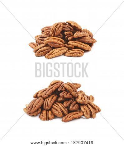 Pile of pecan nuts isolated over the white background, set of two different foreshortenings