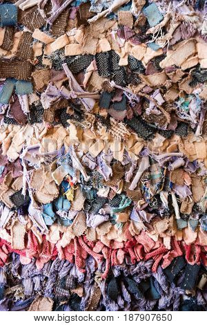 Old fashioned traditional oriental carpet with rags as background