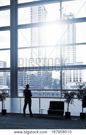 Businessman Looking True Windows