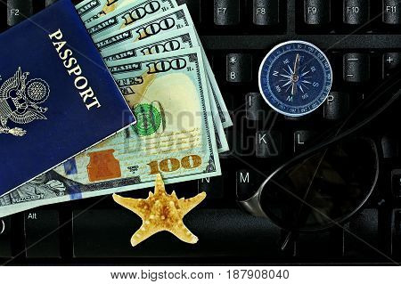 Time for relaxation and tourismKeep keyboard to traveling Overhead view of Traveler's accessories and keyboardTime of award of work Essential vacation items Travel concept background.