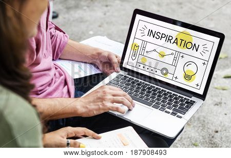 Couple working on laptop network graphic overlay