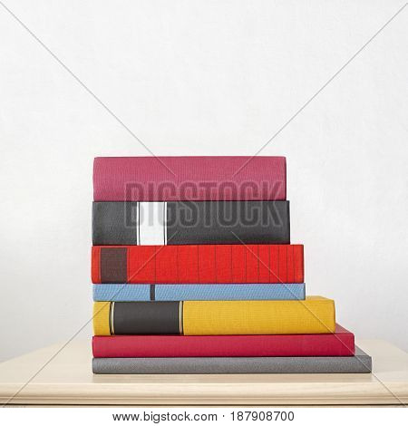stack of new colorful books on the table