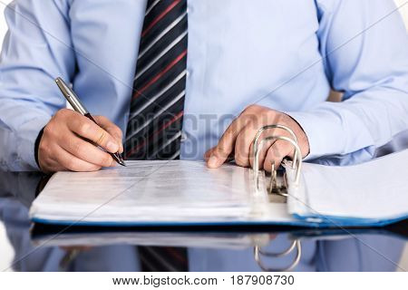 Businessman is signing a file high quality and high resolution studio shoot