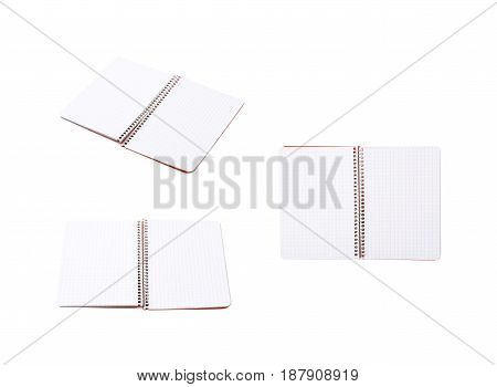 Opened squared paper notebook isolated over the white background, set of three different foreshortenings