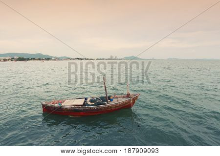 Old fishing boat on the sea coast of Thailandconcept of adventure and livelihood.