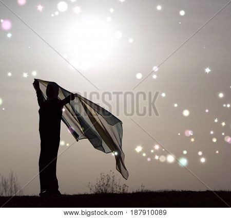 Silhouette of Muslim woman with her scarf