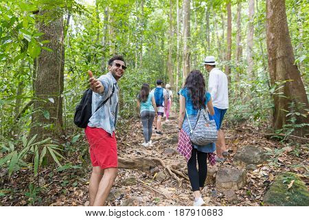 Guy Hold Hand Welcome People Group With Backpacks Trekking On Forest Path Back Rear View, Young Men And Woman On Hike Tourists Hiking