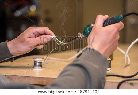 Male Worker Works With Solder Wire
