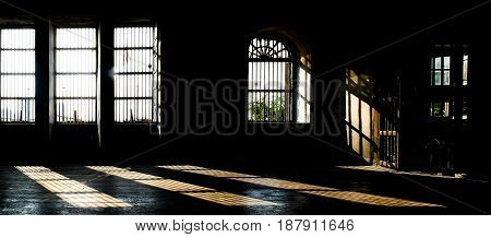 Barred door and windows in abandoned house interior