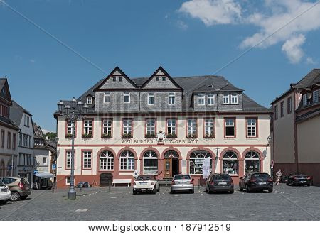 WEILBURG, GERMANY-MAY 22, 2017: Market square with the building of the Weilburger Tageblatt, Weilburg, Hesse, Germany