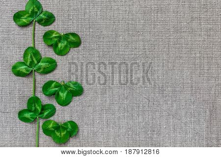 Green Leaves Of Clover On The Background Of Linen Cloth.