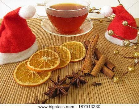 Cup of Christmas tea with rooibos tea and ispices