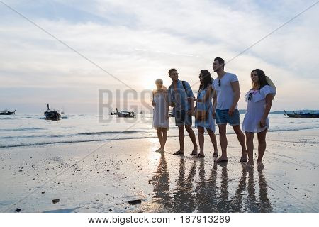 Young People Group On Beach At Sunset Summer Vacation, Friends Walking Seaside Sea Ocean Holiday Travel